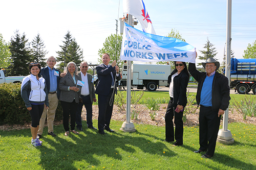 Mayor Maurizio Bevilacqua and Members of Council raise a flag to celebrate National Public Works Week.