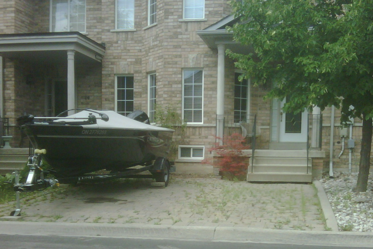 Picture of a boat parked incorrectly on a yard